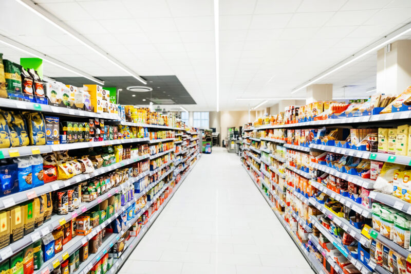 Stock photo of a grocery store aisle.