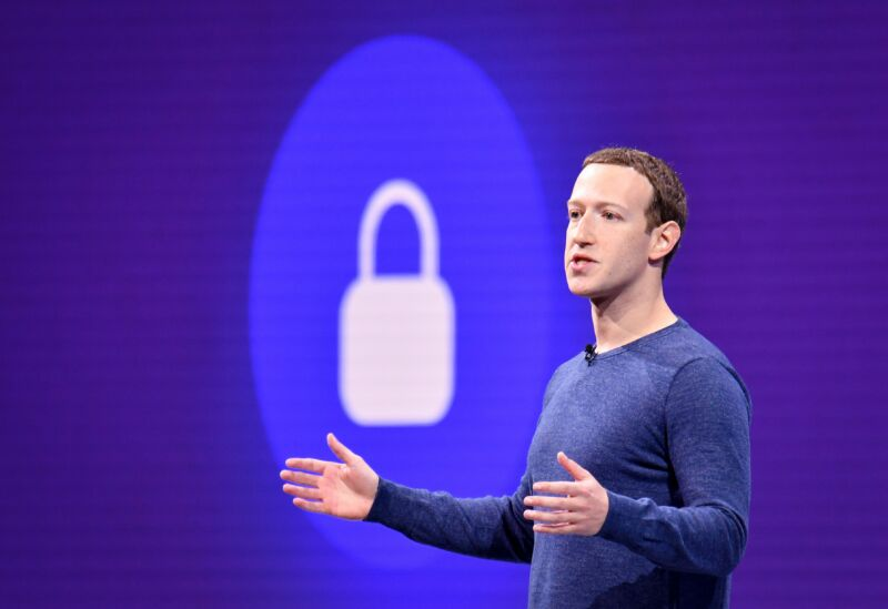 A casually dressed man speaks in front a stylized padlock symbol.