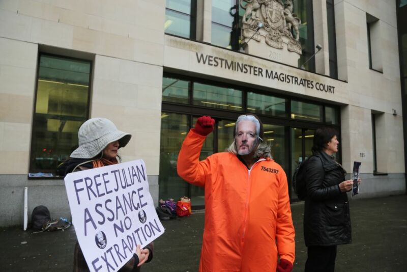 Street protesters dressed to look like Julian Assange.