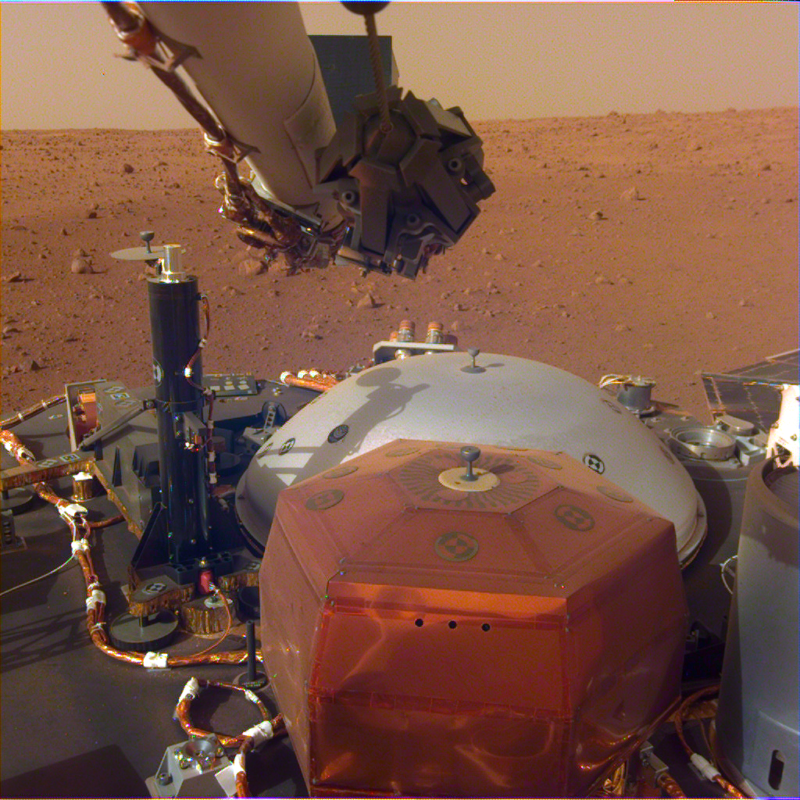 Image of metal hardware on a dusty, reddish landscape.