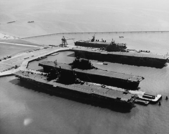 Three American fleet carriers at NAS Alameda, along with the light carrier USS <em>San Jacinto</em>, farthest from the camera. Escort carriers were even smaller than the <em>San Jacinto</em>, so this gives a sense of the relative size of escort carriers compared to fleet carriers.