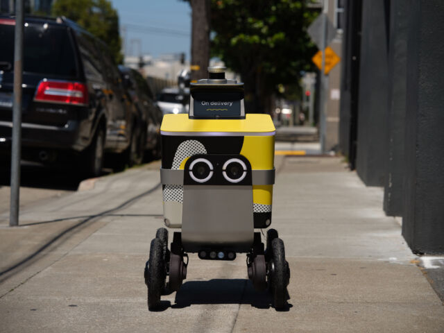 An Ouster sensor atop a Postmates robot.