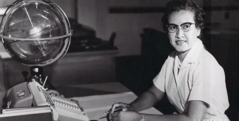 "Katherine Johnson sits at her desk with a globe, or ""Celestial Training Device."""