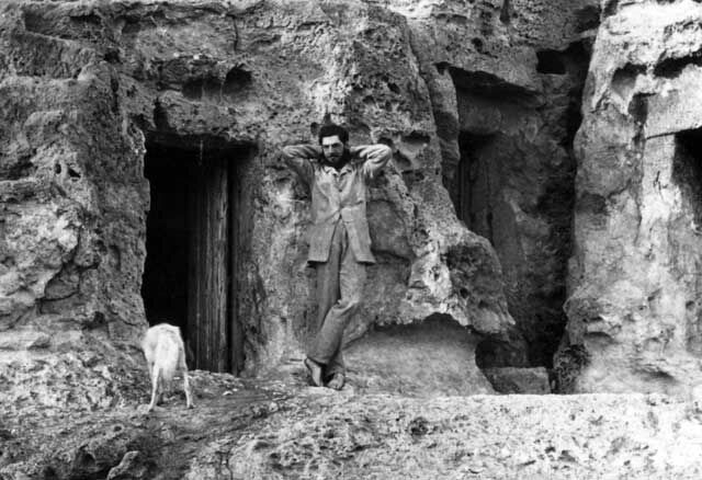 Flinders Petrie outside the tomb that served as his home on          the Giza Plateau. Sadly, this black-and-white image doesn't          allow us to see whether he's dressed in his trademark pink.