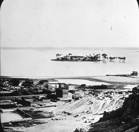 The view from Petrie's tomb. This photograph was taken in          October of 1881, during the Nile's annual inundation, which          changed the character of the landscape markedly. Such a sight          hasn't been seen since the 1960s, when the construction of the          Aswan Dam abruptly ended the dependable ebb and flow which had          dictated the rhythms of Egyptian life for thousands upon          thousands of years.<br />
