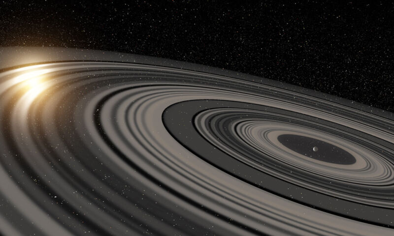 Image of a star obscured by the rings of a planet.