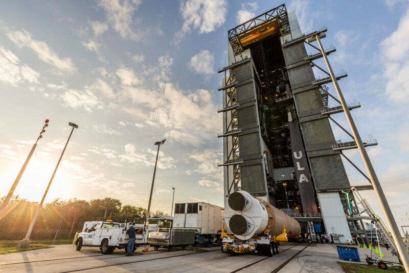 United Launch Alliance hoists its Atlas V booster onto the mobile launch platform adjacent to Space Launch Complex-41 at Cape Canaveral Air Force Station. The rocket will launch the AEHF-6 communications satellite.