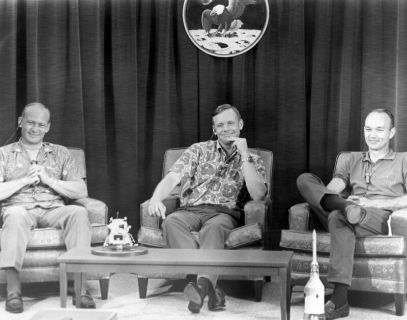 Apollo 11 crew members (L-R) Buzz Aldrin, Neil Armstrong, and Michael Collins are amused by a question posed shortly before launch.