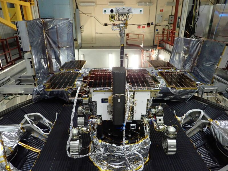 Image of a rover's camera mast and solar panels.