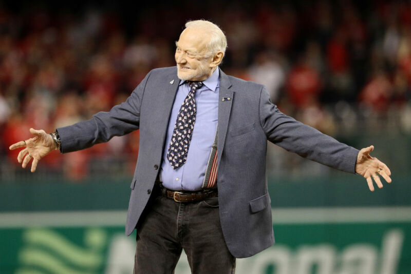 A cheerful old man in a baseball field.