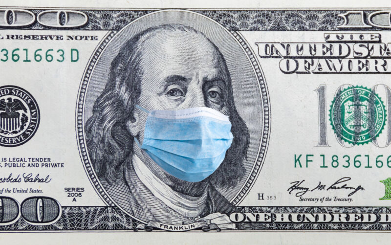 Image of 100-dollar bill with a surgical mask photoshopped across Benjamin Franklin's face.
