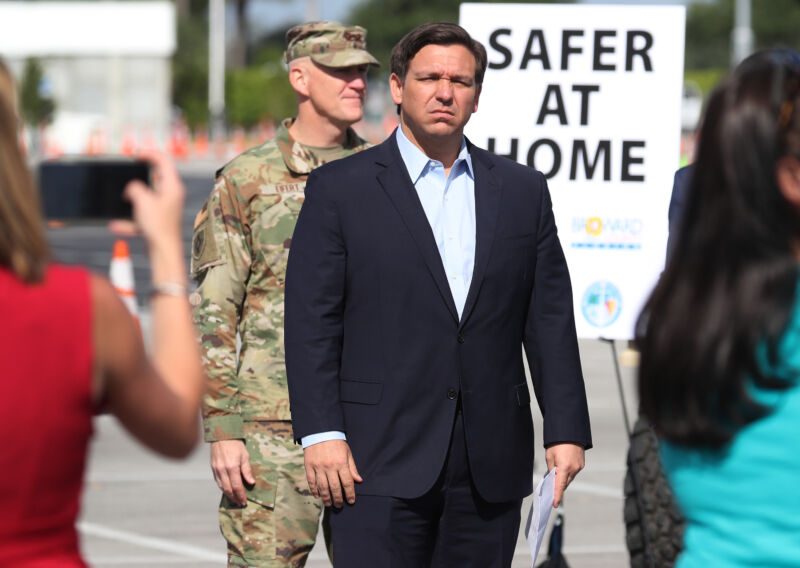 MIAMI GARDENS, FLORIDA - MARCH 30:  Florida Gov. Ron DeSantis attends a news conference in the Hard Rock Stadium parking lot on March 30, 2020 in Miami Gardens, Florida.