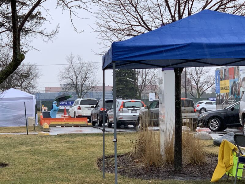 Patients wait in their cars for drive-through COVID-19 testing at Advocate Lutheran General Hospital in Park Ridge, IL, on Thursday, March 19. The hospital suspended drive-through testing on Friday due to a shortage of test kits.