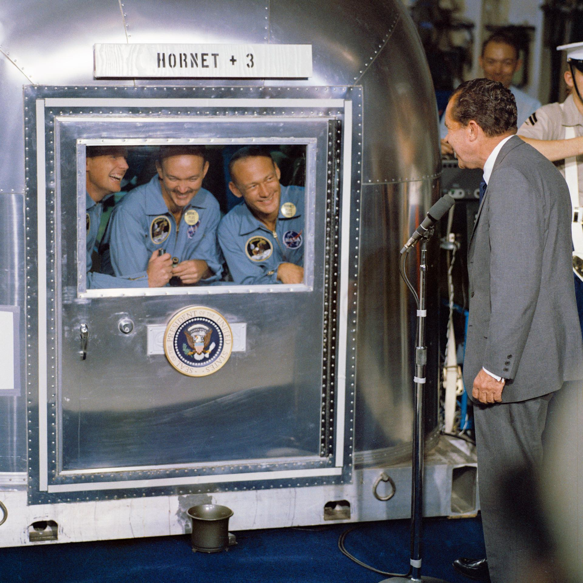 President Richard M. Nixon visits the central Pacific recovery area to welcome the Apollo 11 astronauts aboard the USS <em>Hornet</em>, prime recovery ship for Apollo 11. Aldrin is at right.