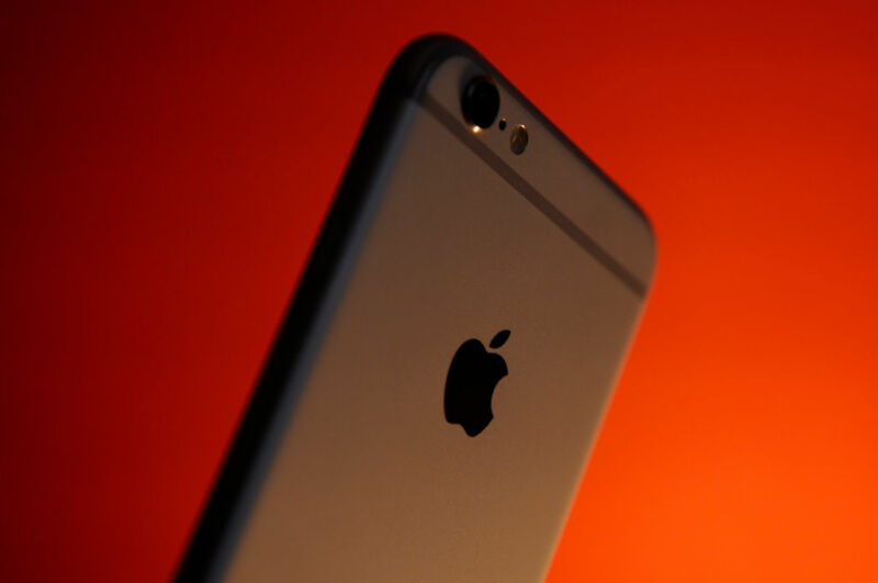 An iPhone 6 pictured from behind, showing the Apple logo.