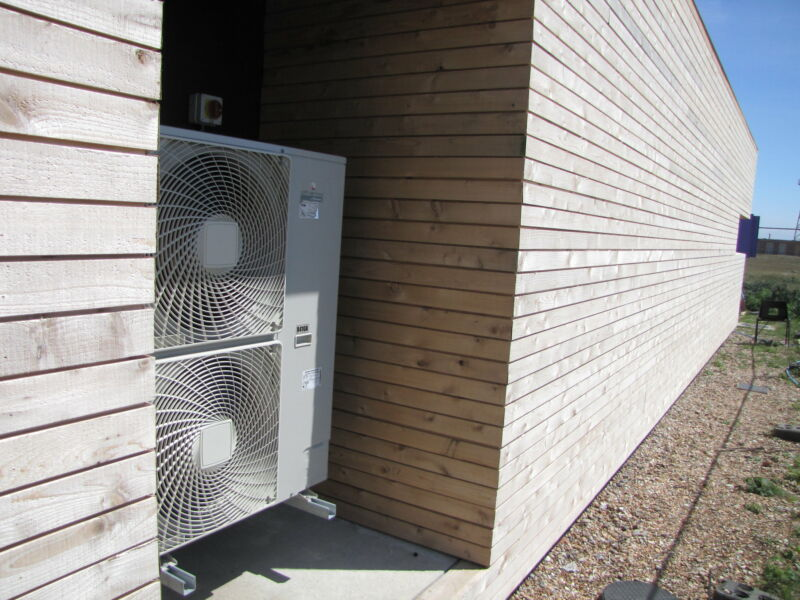An air source heat pump nestled in a nook.