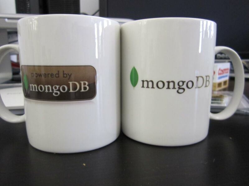 Coffee mugs with MongoDB logos on them.