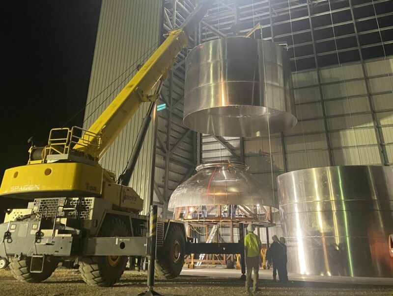 Three barrels welded together are lowered onto a pressure dome for SN2 at the South Texas Launch Site this week.