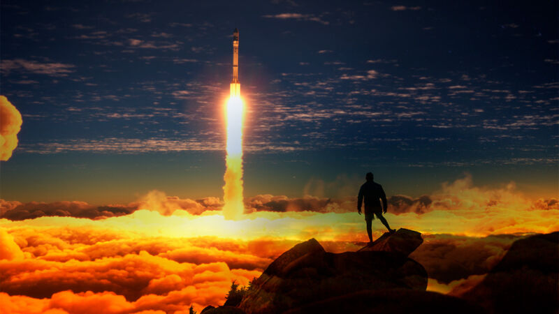 Photoshopped image of a silhouetted person watching a rocket liftoff.