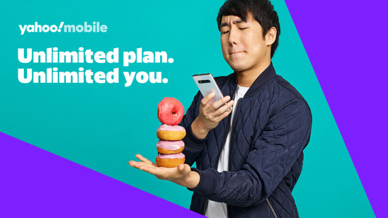 An ad for Yahoo Mobile showing a man taking a picture with a smartphone, with text that says