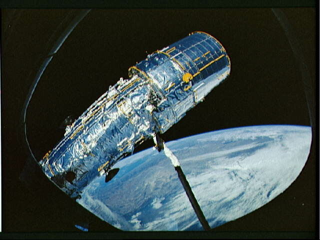 Hubble Space Telescope solar array panel deployment during STS-31.