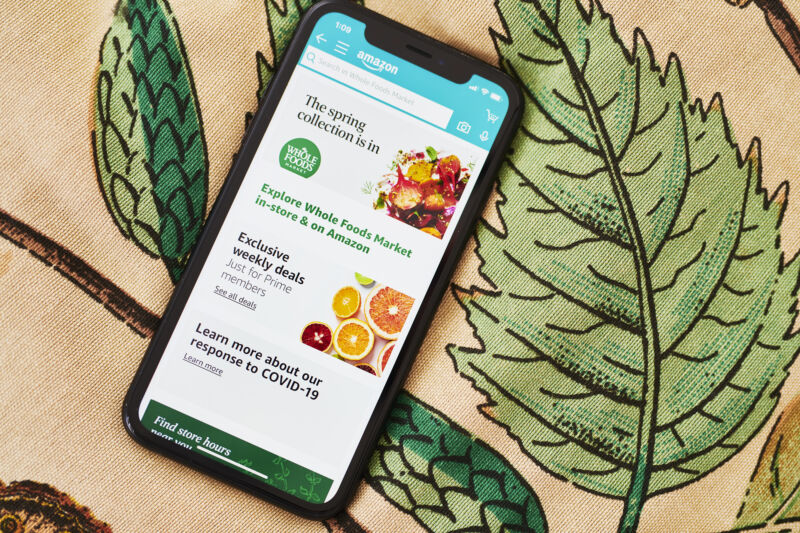 A smartphone displays the Whole Foods app.