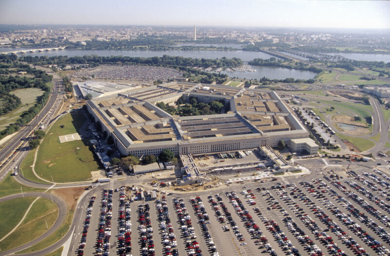 An aerial view of the Pentagon, the Potomac river, and parts of Washington, DC, taken back before a pandemic started keeping most of those cars in the commuter lot at home.