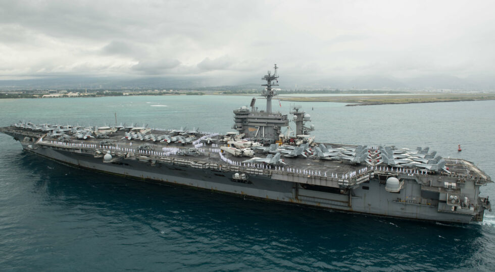 The aircraft carrier USS <em>Theodore Roosevelt</em> arriving at Pearl Harbor in 2018.