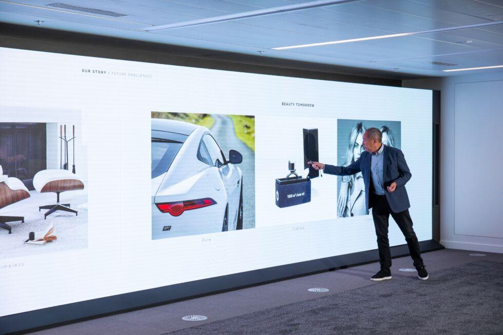Jaguar's director of design, Julian Thomson, stands in front of a gargantuan display at the company's new design studio.