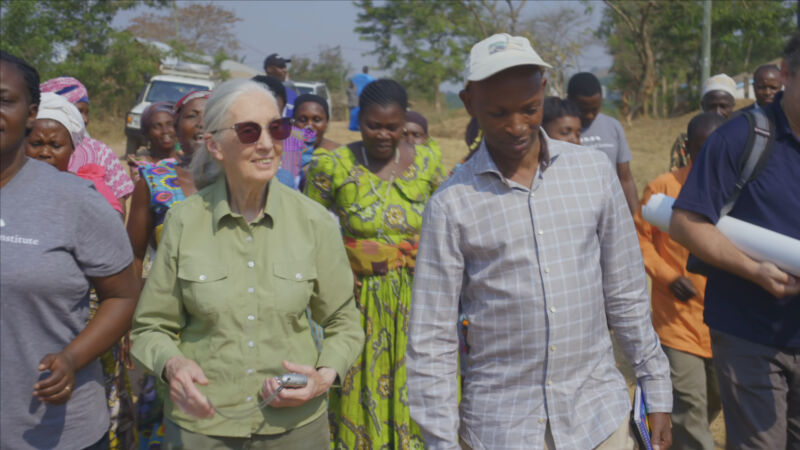 Dr. Jane Goodall walking with local villagers and staff members of TACARE, one of the many programs of the Jane Goodall Institute.