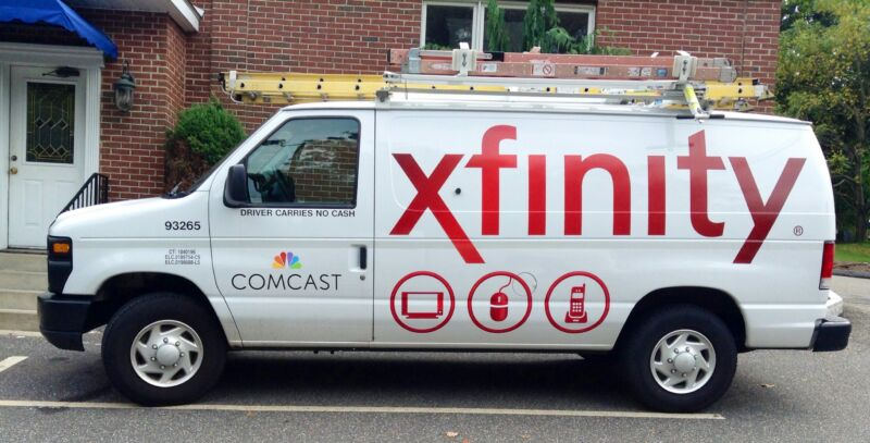 A Comcast service van parked outside a residence.