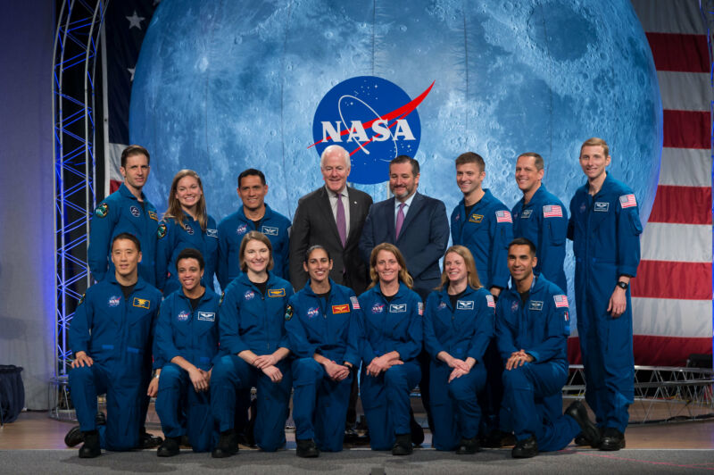 Senator John Cornyn (center, black suit) takes a photo with the 2017 astronaut class.