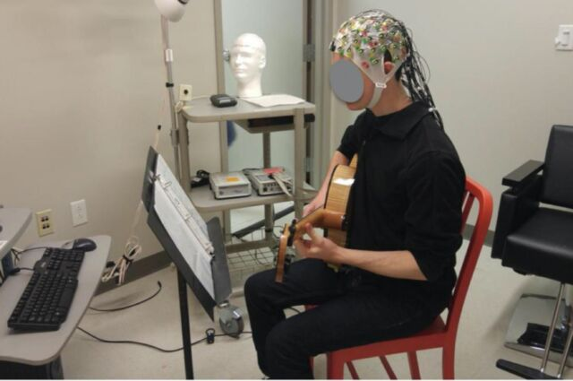 A jazz guitar player improvising while his brain activity (EEG) is recorded.