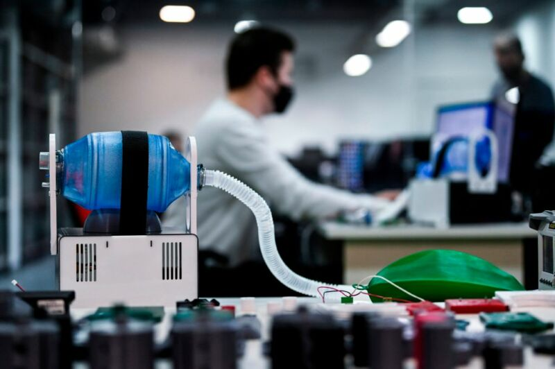 A man performs a test at a ventilator manufacturing workshop at the offices of Formon, a 3D printer manufacturer in Pristina, Kosovo on April 5, 2020.