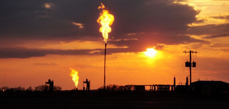 Image of fossil fuel wells and the flames powered by vented gasses.