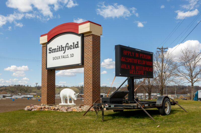 A sign outside the Smithfield Foods pork processing plant, one of the country's largest known Coronavirus clusters, is seen on April 21, 2020 in Sioux Falls, South Dakota.