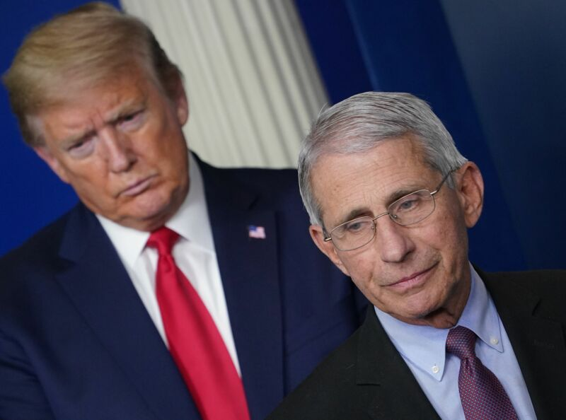 Director of the National Institute of Allergy and Infectious Diseases Anthony Fauci, flanked by US President Donald Trump, speaks during the daily briefing on the novel coronavirus, which causes COVID-19, in the Brady Briefing Room of the White House on April 22, 2020, in Washington, DC.