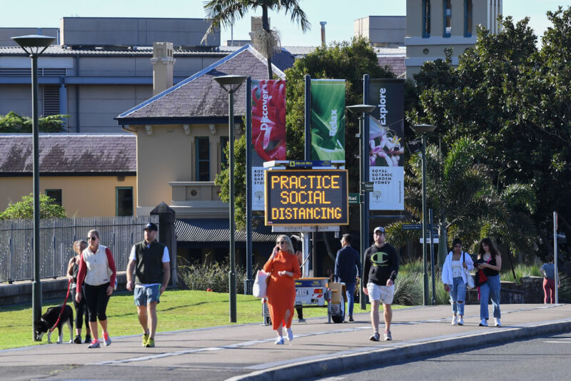People walk past a social distancing sign outside the Royal Botanic Garden on May 31, 2020 in Sydney, Australia. Policy decisions to re-open facilities or to encourage citizens to shelter in place don't come out of nowhere—there's often (hopefully) data behind the scenes.