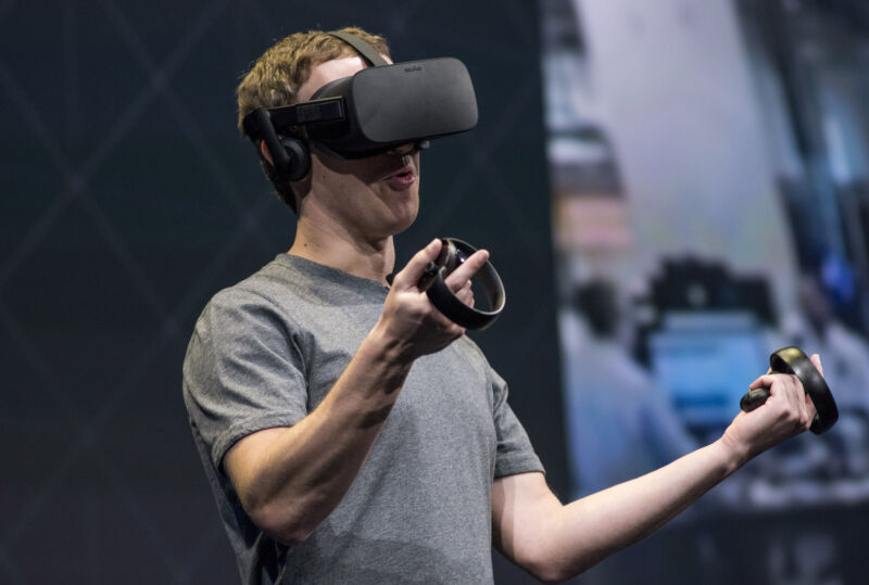 Mark Zuckerberg demonstrates an Oculus Rift headset at a 2016 event.
