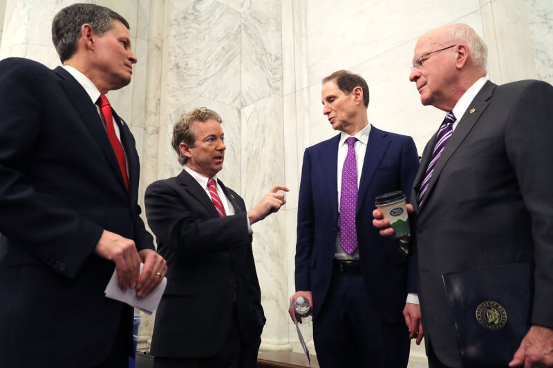 Sen. Steve Daines (R-Mont.), Sen. Rand Paul (R-Ky.), Sen. Ron Wyden (D-Ore.) and Sen. Patrick Leahy (D-Vt.) speak in January. The four men are leading advocates for limiting government surveillance powers.
