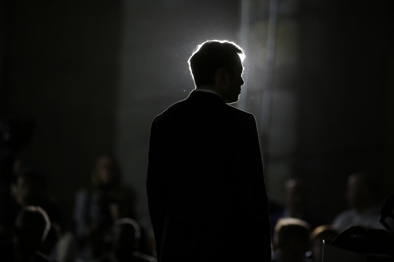 Elon Musk listens as Chicago Mayor Rahm Emanuel talks about constructing a high speed transit tunnel at Block 37 during a news conference on June 14, 2018 in Chicago, Illinois.