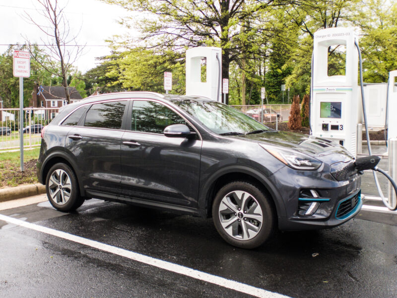 A Kia Niro EV plugged into a DC fast charger