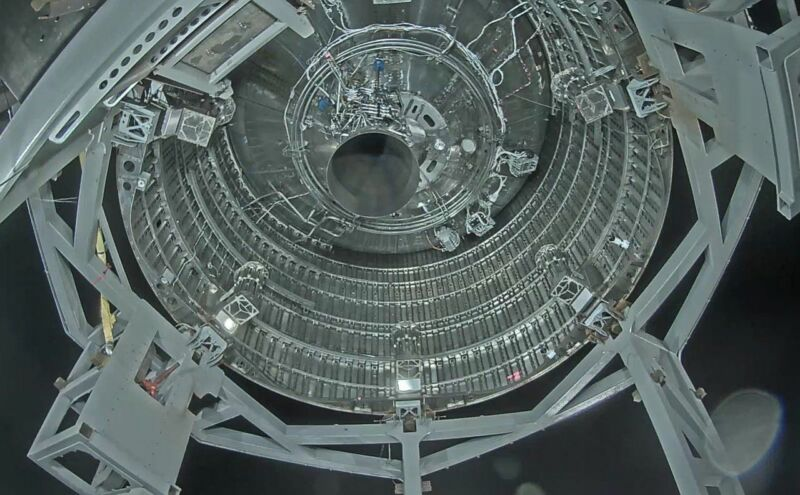A view into the maw of SN4, showing a single Raptor engine mounted inside.