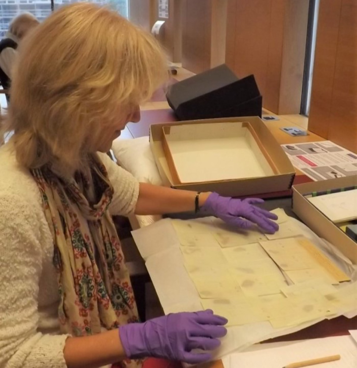 Image: JJoan Taylor examining the Dead Sea Scroll fragments in the John Rylands Reading Room. Photos: University of Manchester
