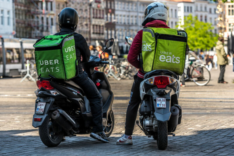 Two Uber Eats delivery courier wait outside Mc Donalds fast food in Ghent, Belgium on May 14, 2020. As Belgium takes steps in easing Restrictions, Restaurant and cafe are not allowed to open to customers only fast food and take away is allowed. restaurants and restaurants may not reopen before June 8.  (Photo by Jonathan Raa/NurPhoto via Getty Images)