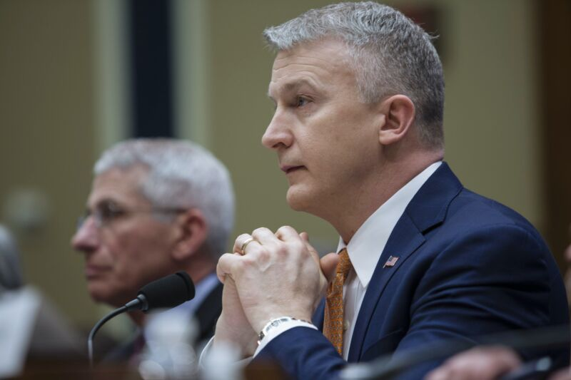 US health officials Rick Bright and Anthony Fauci sit at a table during a congressional hearing.