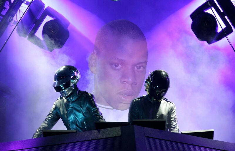 Jay-Z's visage hovers over a pair of robot DJs.
