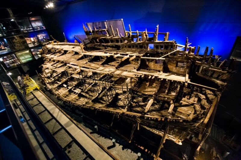 """The hull of Henry VIII's favorite warship, the <em>Mary Rose</em>, and many thousands of recovered artifacts are housed in the Mary Rose Museum in Portsmouth, England.""""><figcaption class="""