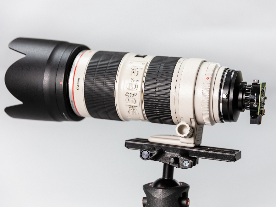 With an adapter, you can also attach, much, much bigger lenses.