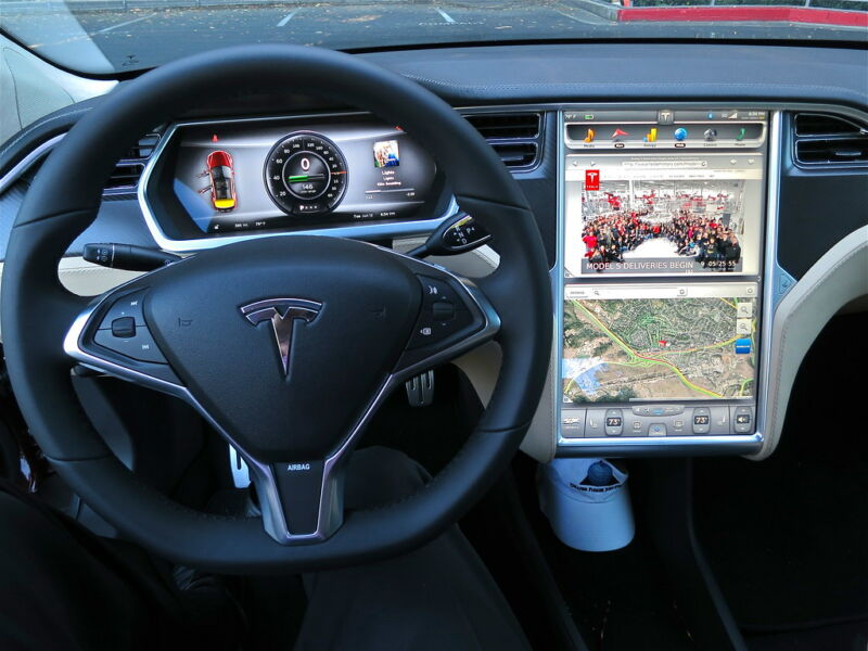 Steering wheel and infotainment center for a Tesla automobile.